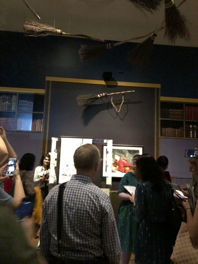 As you enter the New-York Historical Society exhibition, brooms fly overhead.