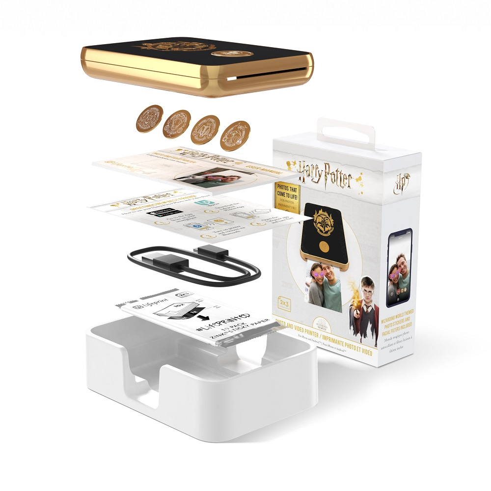 Harry Potter Magic Photo and Video Printer in black, with included accessories: Hogwarts House medallions, USB charging cord, printer paper and instructions on augmented reality