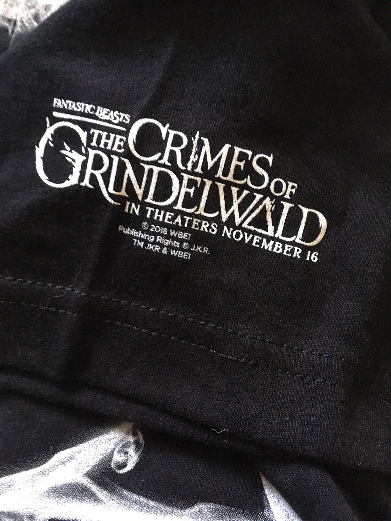 """Fantastic Beasts: The Crimes of Grindelwald"" back side of T-shirt showing film logo"