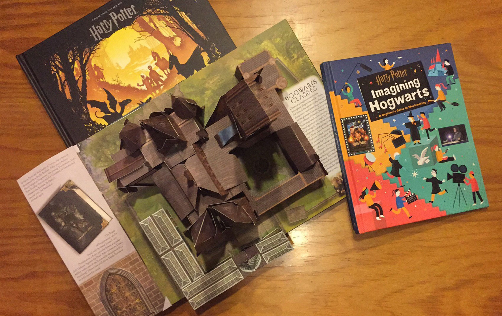 "Insight Editions book bundle: ""Harry Potter: A Pop-Up Guide to Hogwarts"", ""Harry Potter: Creatures: A Paper Scene Book"", and ""Harry Potter: Imagining Hogwarts: A Beginner's Guide to Moviemaking"""