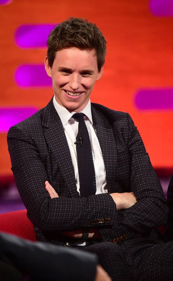 "Eddie Redmayne sits on the couch on ""The Graham Norton Show""."