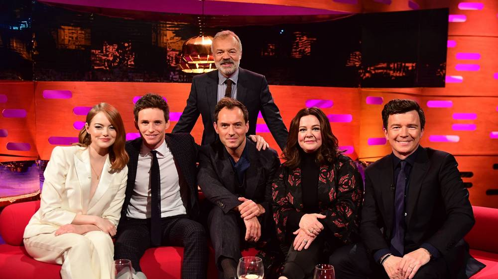 "Eddie Redmayne and Jude Law pose for a group photo on ""The Graham Norton Show""."