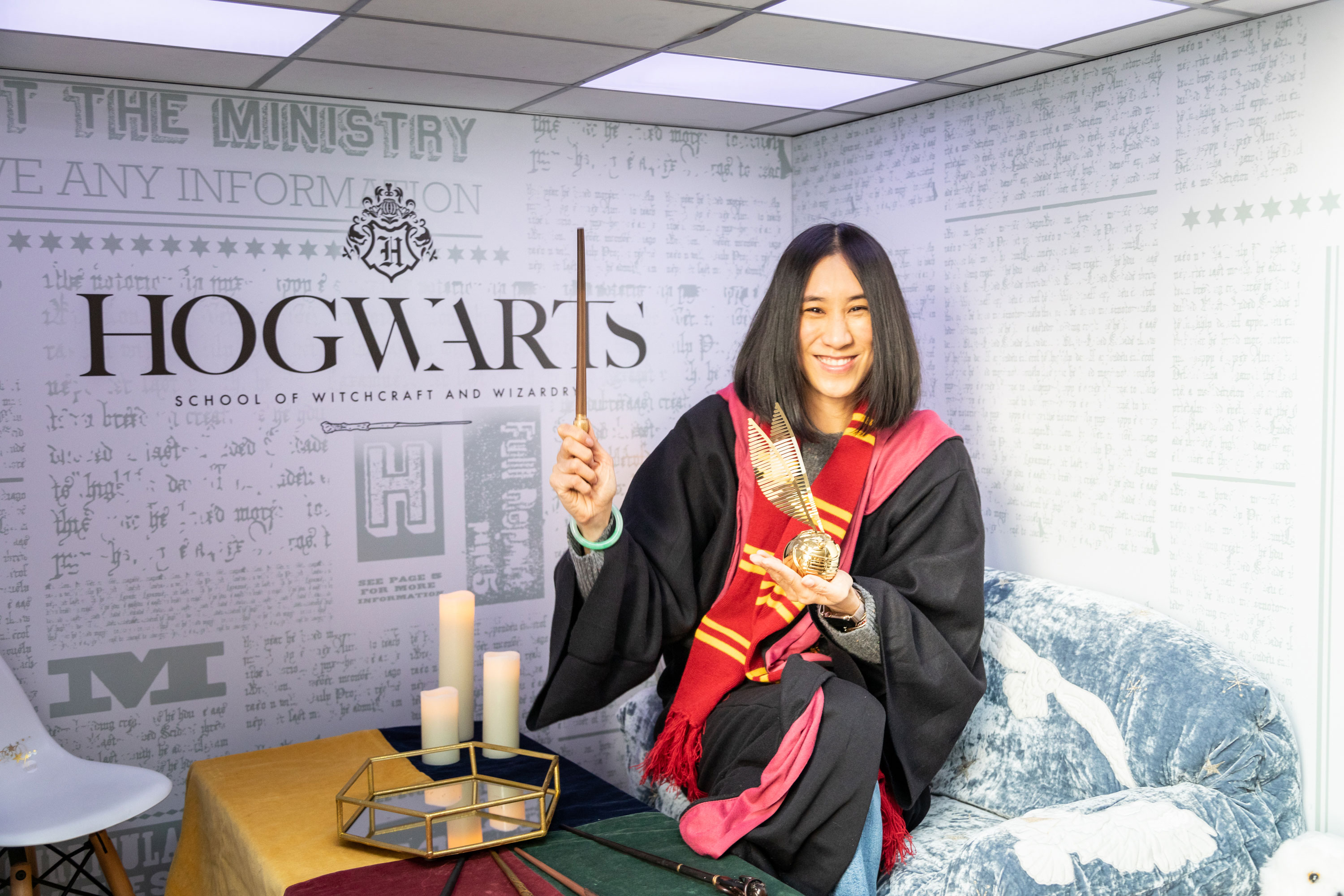 Eva Chen is dressed in Gryffindor House colors, ready to cast a spell.