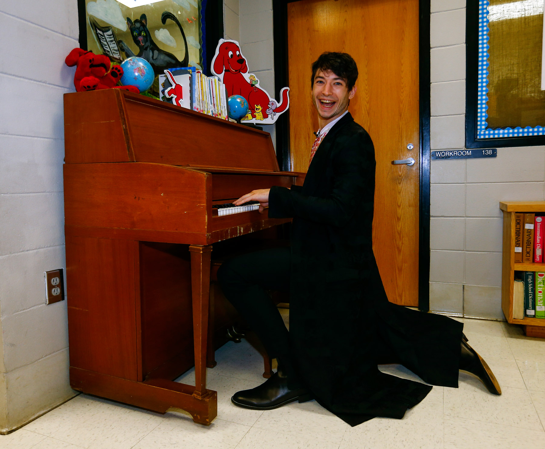 """Ezra Miller from """"Fantastic Beasts: The Crimes of Grindelwald"""" plays the piano as he helps celebrate Wizarding World Day at Parkside Middle School in Baileyton, AL.  (Photo by Butch Dill/Getty Images)"""