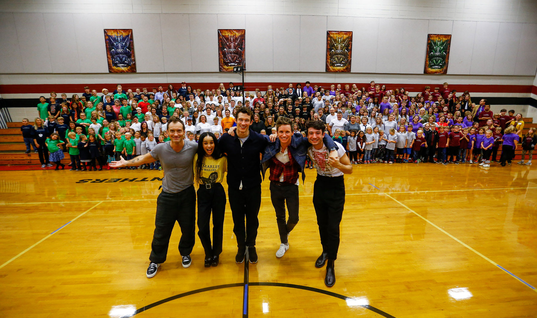 """Cast members from """"Fantastic Beasts: The Crimes of Grindelwald"""" celebrate Wizarding World Day at Parkside Middle School in Baileyton, AL.(Photo by Butch Dill/Getty Images)"""