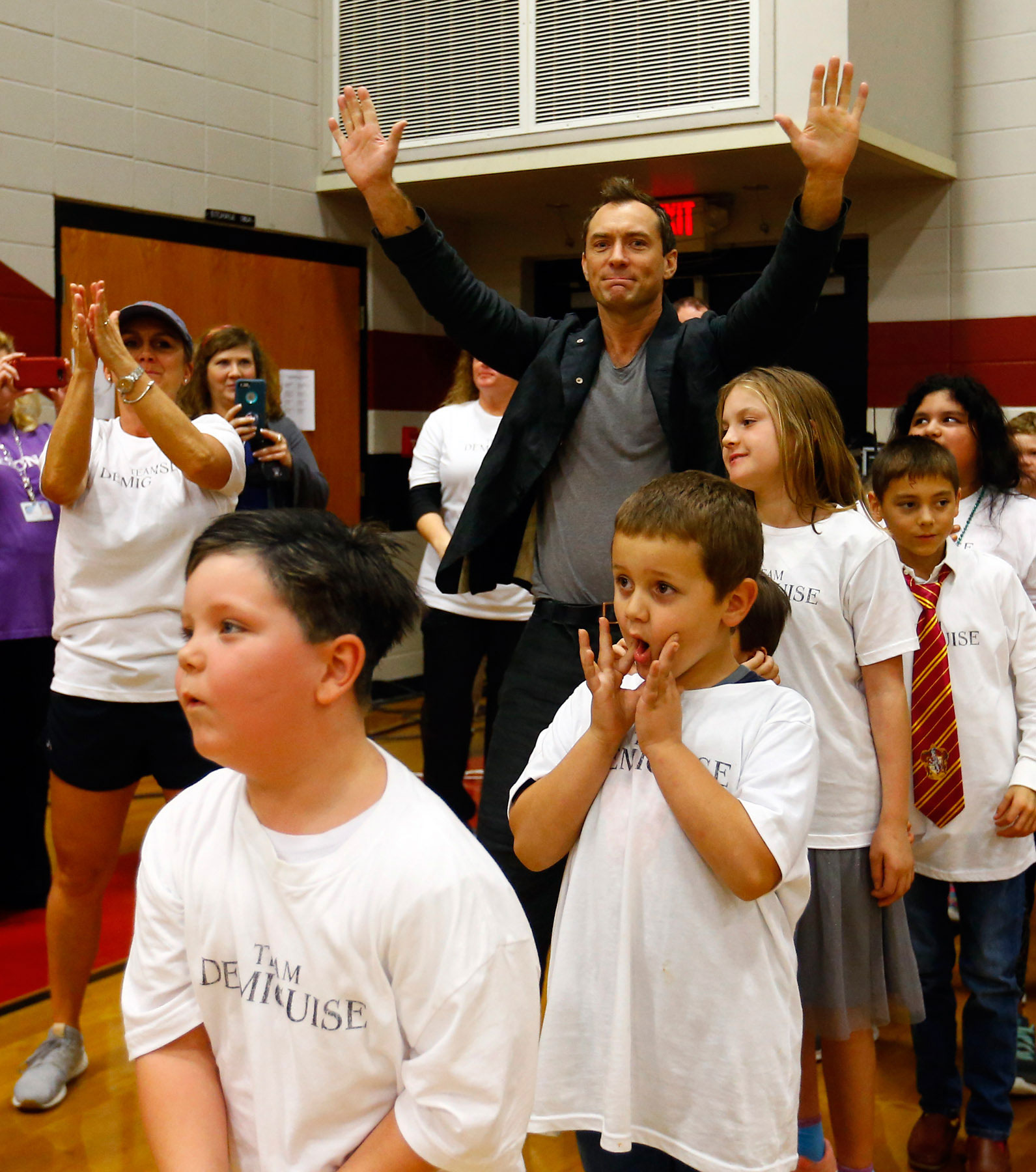 """Jude Law from """"Fantastic Beasts: The Crimes of Grindelwald"""" celebrates Wizarding World Day at Parkside Middle School in Baileyton, AL.  (Photo by Butch Dill/Getty Images)"""