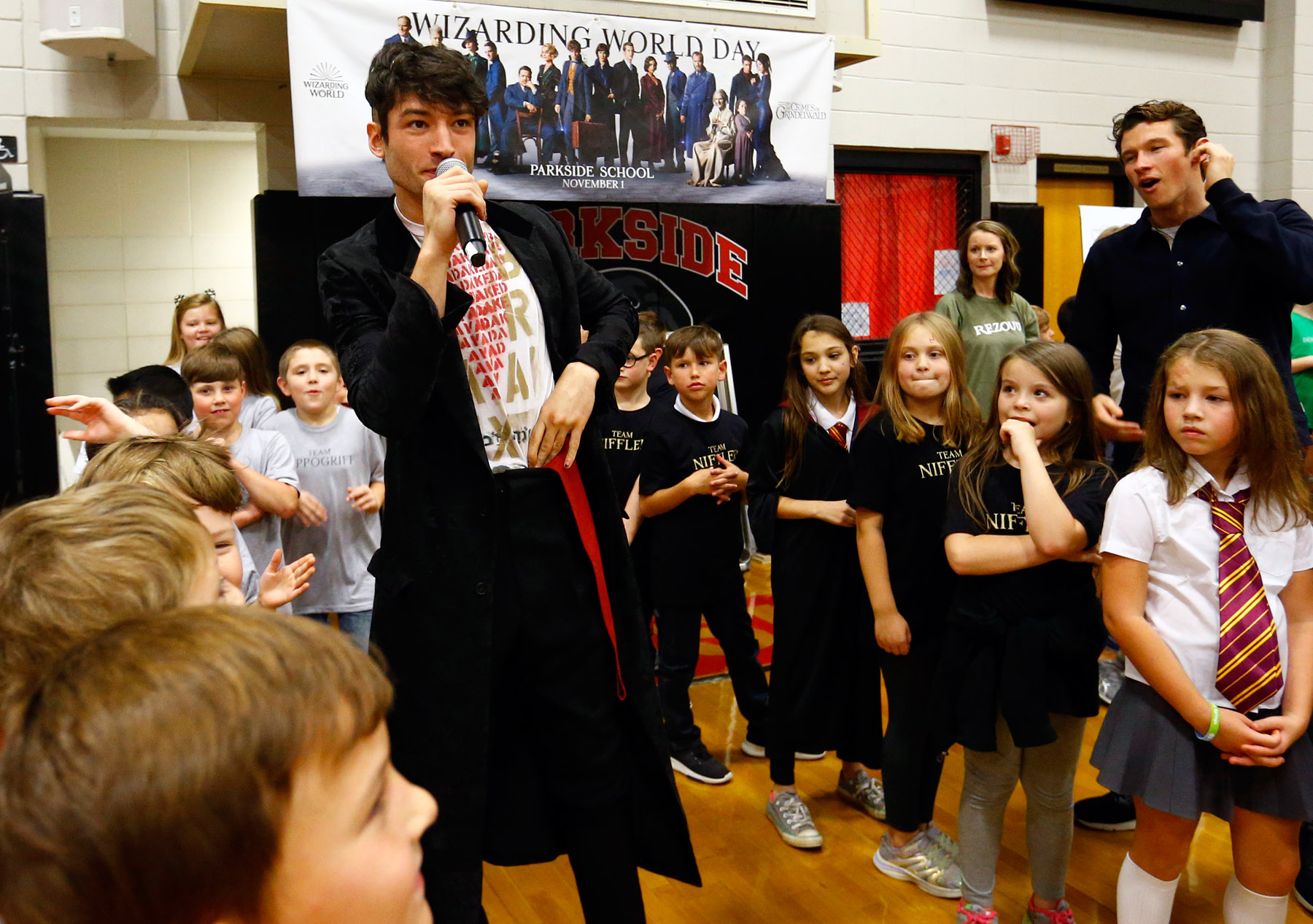 """Ezra Miller from """"Fantastic Beasts: The Crimes of Grindelwald"""" celebrates Wizarding World Day at Parkside Middle School in Baileyton, AL.  (Photo by Butch Dill/Getty Images)"""
