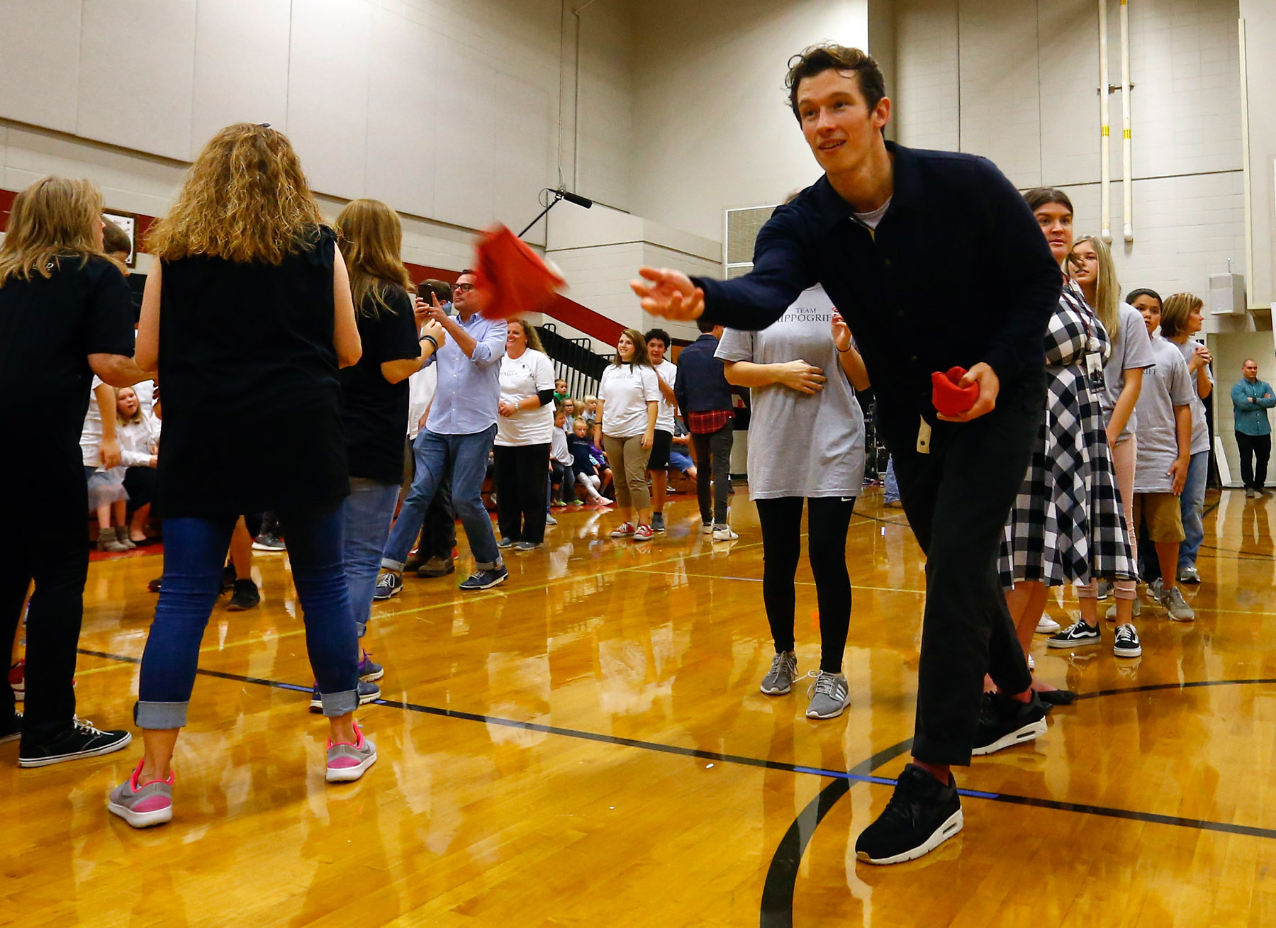 """Callum Turner from """"Fantastic Beasts: The Crimes of Grindelwald"""" celebrates Wizarding World Day at Parkside Middle School in Baileyton, AL.  (Photo by Butch Dill/Getty Images)"""