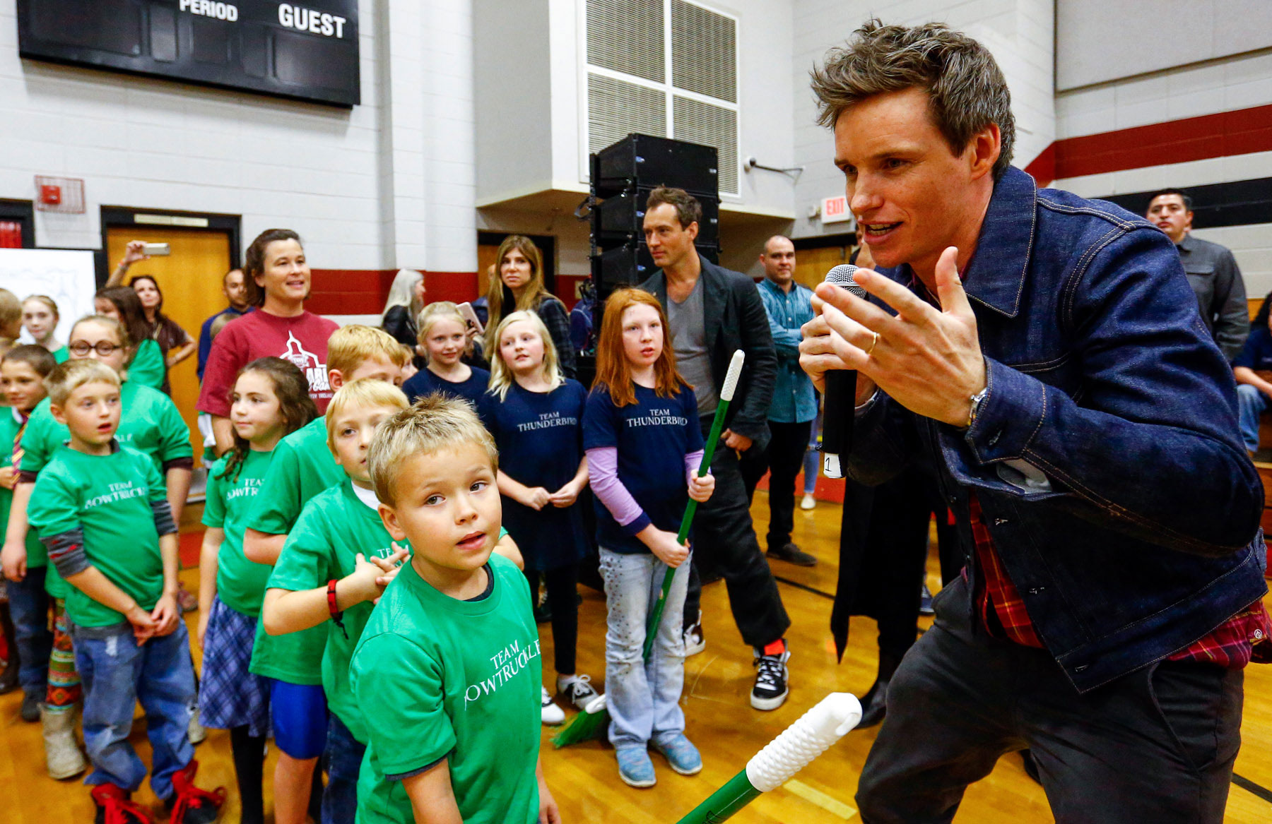 """Eddie Redmayne from """"Fantastic Beasts: The Crimes of Grindelwald"""" talks to students to help celebrate Wizarding World Day at Parkside Middle School in Baileyton, AL.  (Photo by Butch Dill/Getty Images)"""