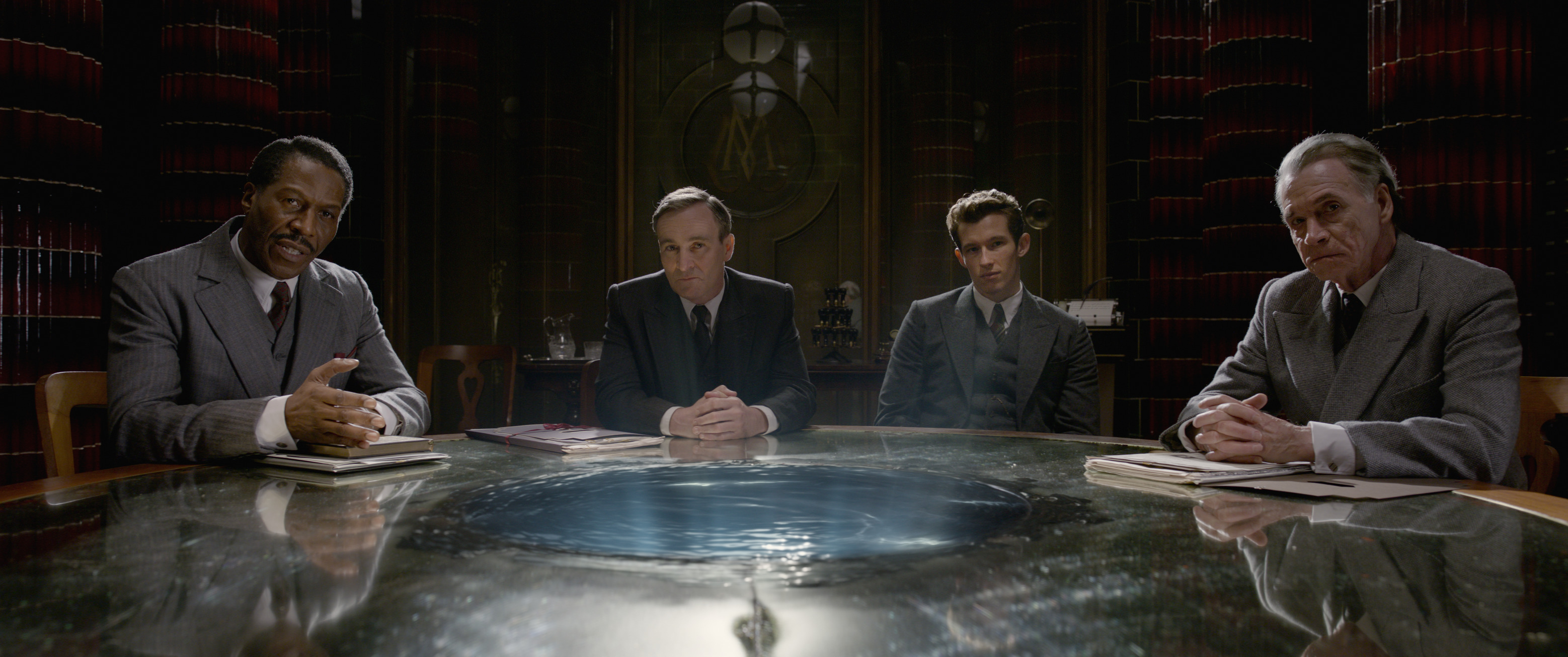 """Fantastic Beasts: The Crimes of Grindelwald"": Arnold Guzman (Cornell S. John), Torquil Travers (Derek Riddell), Theseus Scamander (Callum Turner), and Spielman (Wolf Roth)"