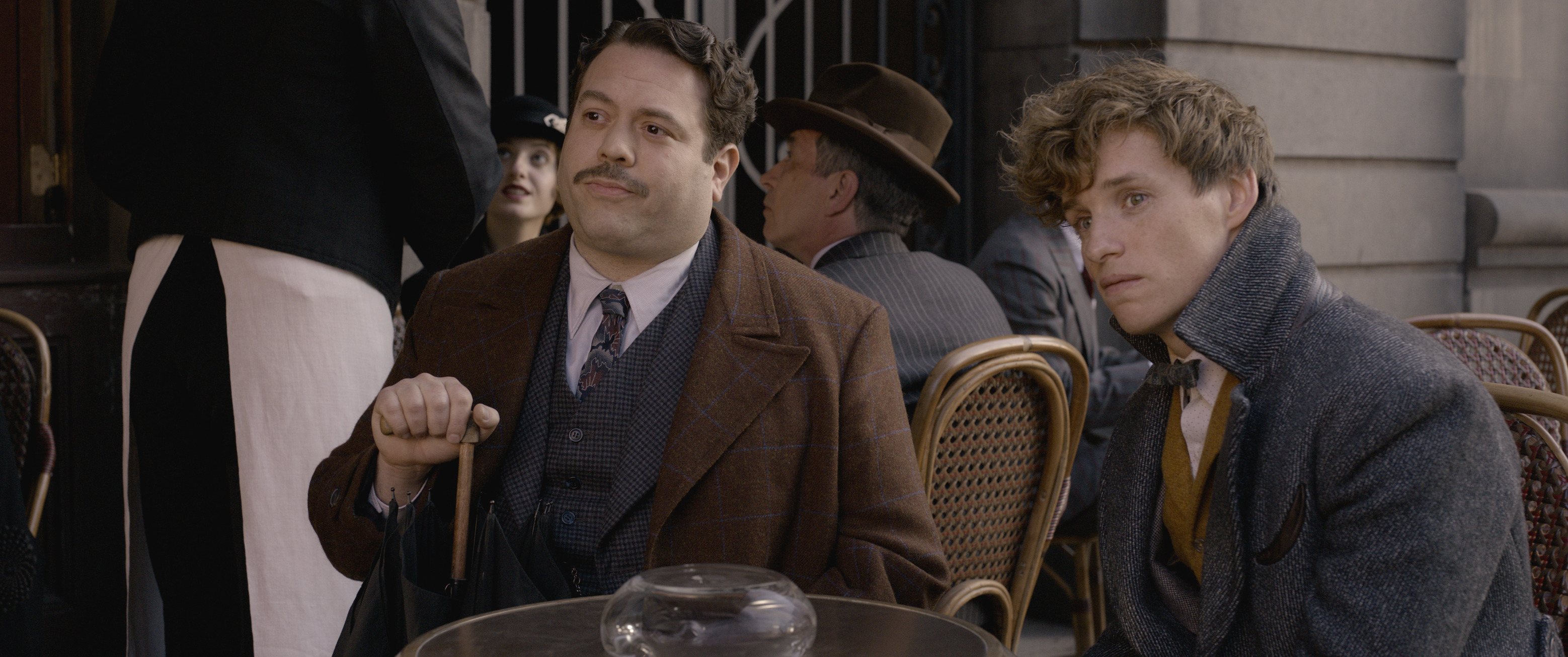 """Fantastic Beasts: The Crimes of Grindelwald"": Jacob Kowalski (Dan Fogler) and Newt Scamander (Eddie Redmayne)"