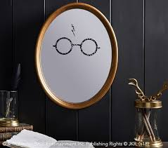 """Mirror, mirror on the wall, who is the most magical of them all? The """"Harry Potter"""" gold wizard mirror will have you checking your reflection in the mirror just to see yourself with those glasses and scar."""