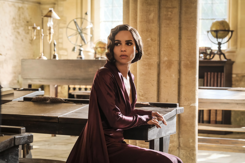 Leta Lestrange sits at a desk.
