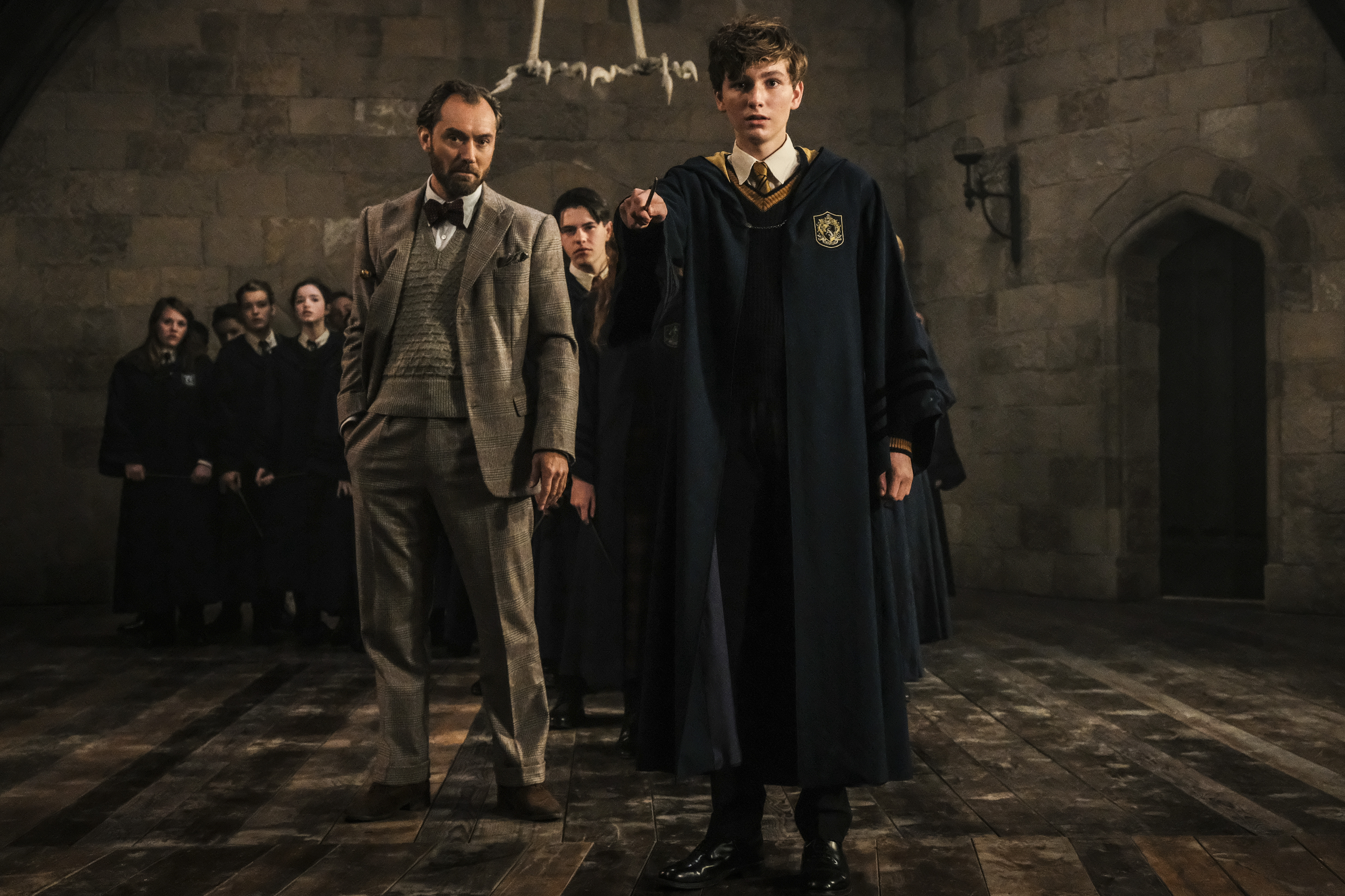 Albus Dumbledore, Newt Scamander, and others in Defense Against the Dark Arts class