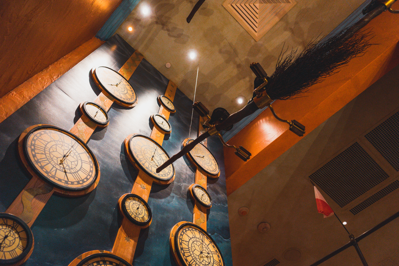 These clocks on the wall include shout-outs to the wizarding world's graphic designers.