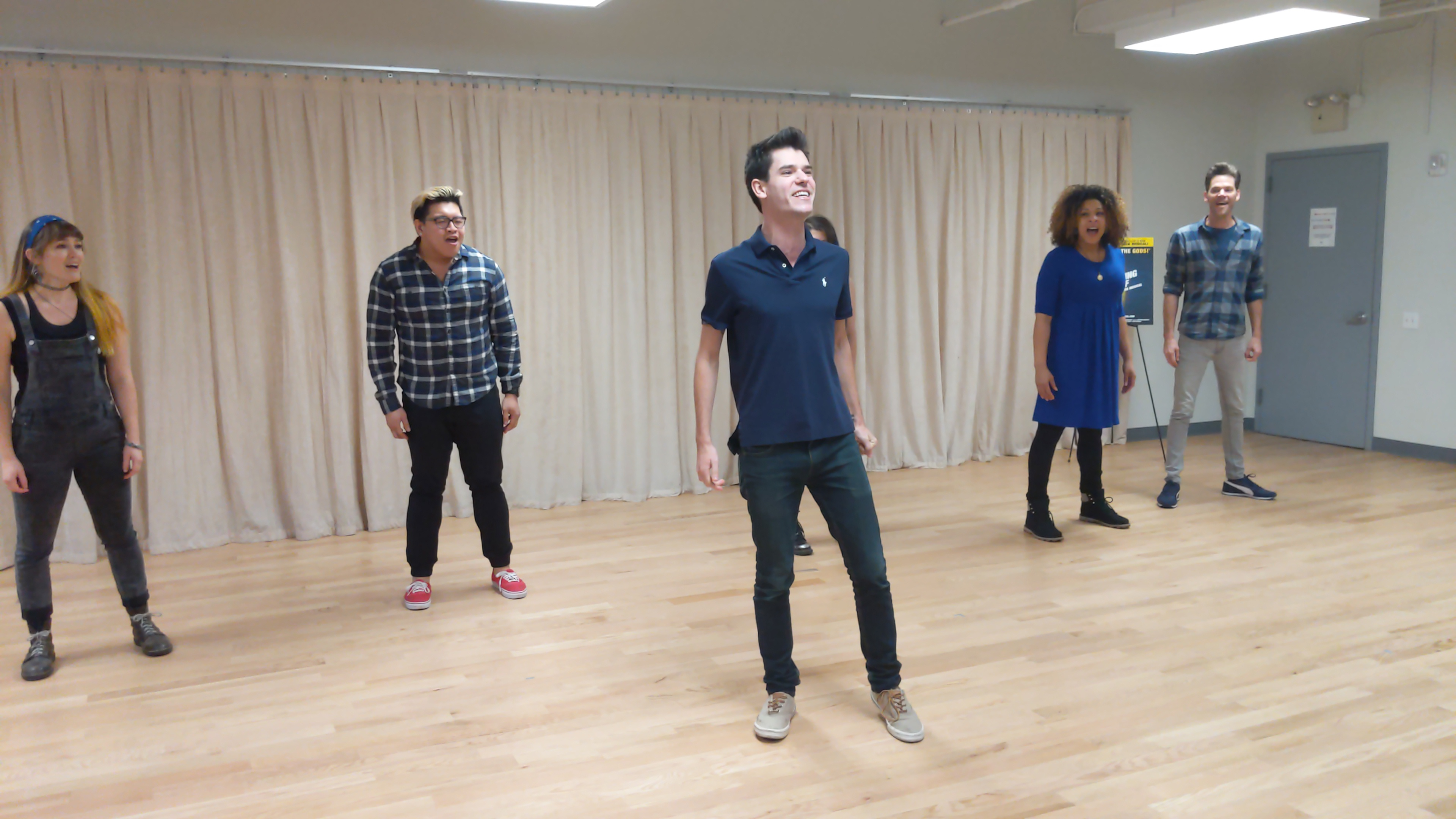 """From left to right, Kristin Stokes (Annabeth), Jorrel Javier (Grover), Chris McCarrell (Percy), Jalynn Steele (Camp Half Blood camper), and Ryan Knowles (Chiron) perform """"Bring on the Monsters."""""""