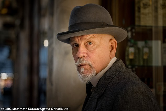 Malkovich decided to take the character in a different direction by opting for a beard and smaller mustache rather than the immense mustache that Christie describes in the novel.
