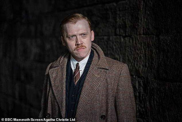 """Rupert Grint, whom most know as Ron Weasley from the """"Harry Potter"""" series, stars alongside Malkovich as Inspector Crome."""