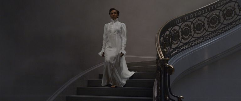 Laurena Kama on the stairs after the special effects have been added.