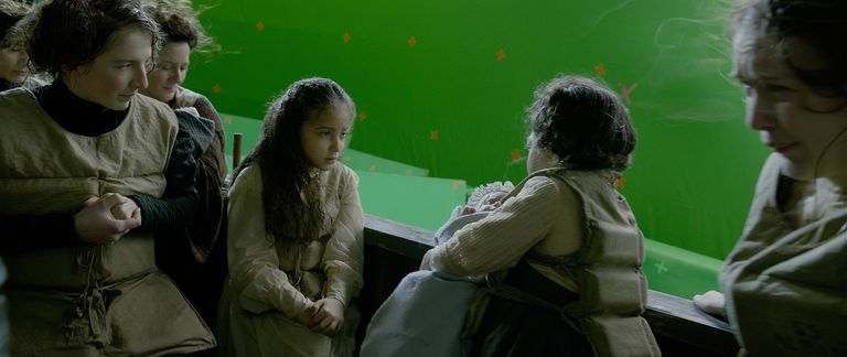 Leta, Irma, and Aurelius on the boat to safety before special effects have been added.
