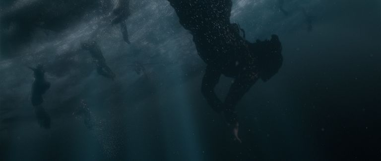 Credence's aunt dives for the baby after special effects have been added.