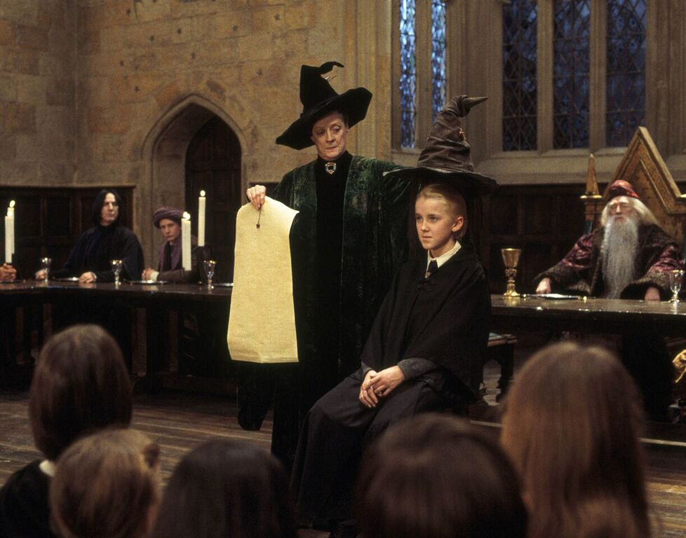 Draco waits to be Sorted into Slytherin House.
