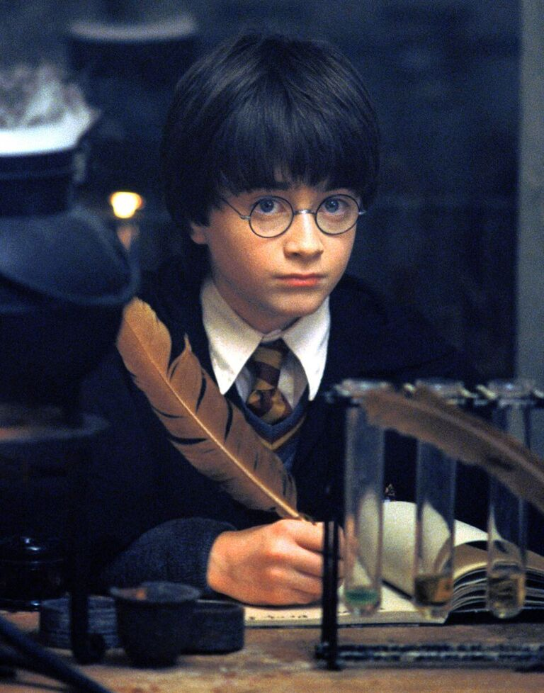 Harry takes notes on his first day of Potions class.