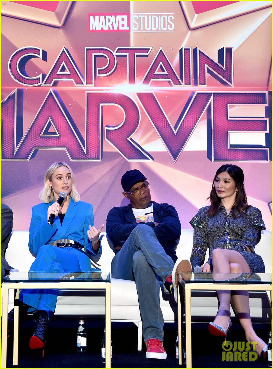 Brie Larson, left, answers a question as Samuel L. Jackson and Gemma Chan listen.