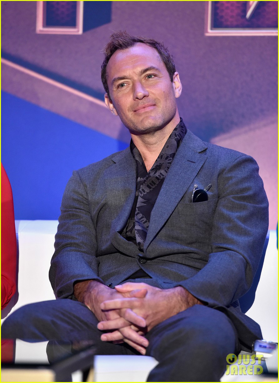 """Jude Law listens as his castmates talk during the """"Captain Marvel"""" press junket."""