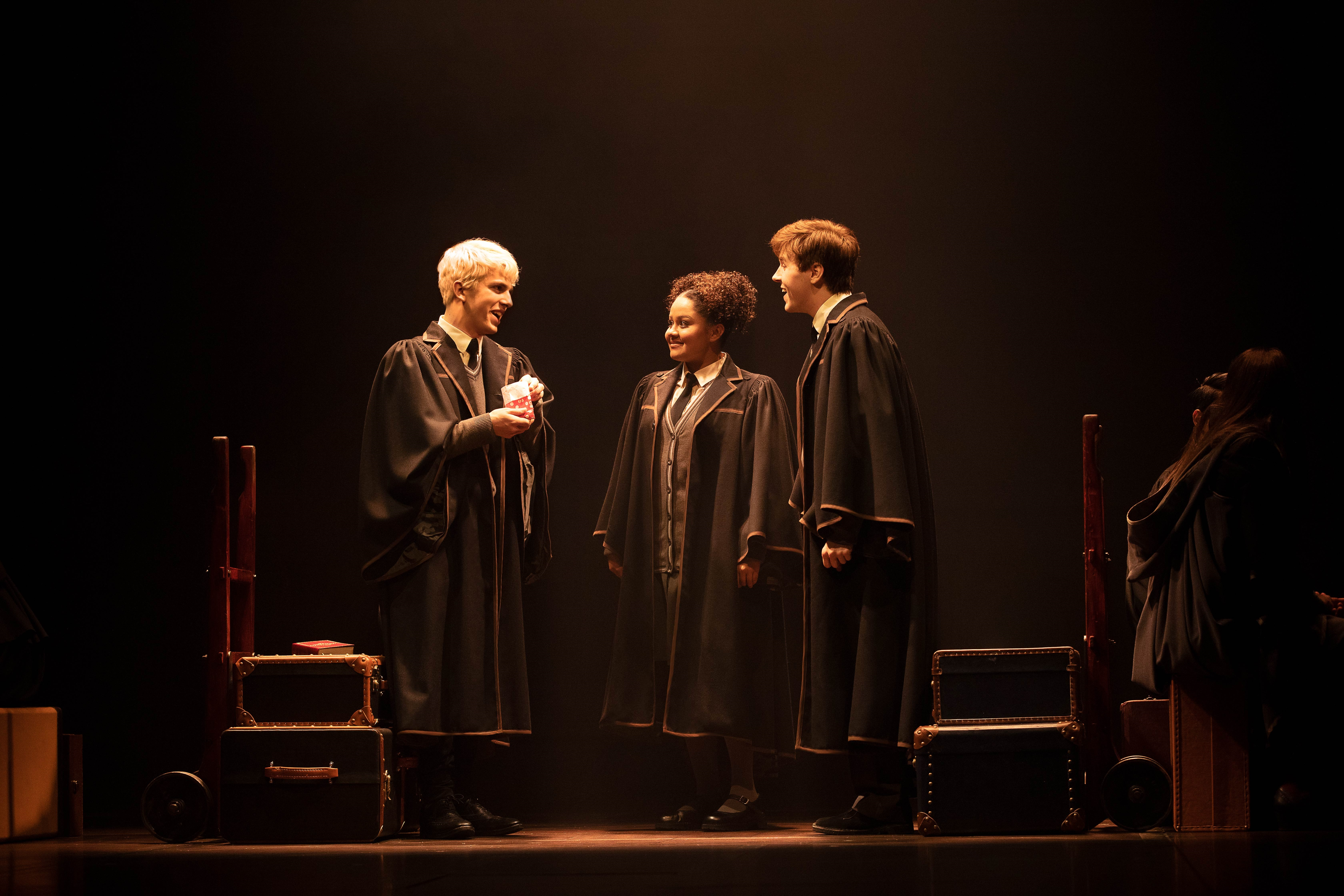 Scorpius Malfoy (William McKenna), Rose Granger-Weasley (Manali Datar), and Albus Potter (Sean Rees-Wemyss) converse aboard the Hogwarts Express.