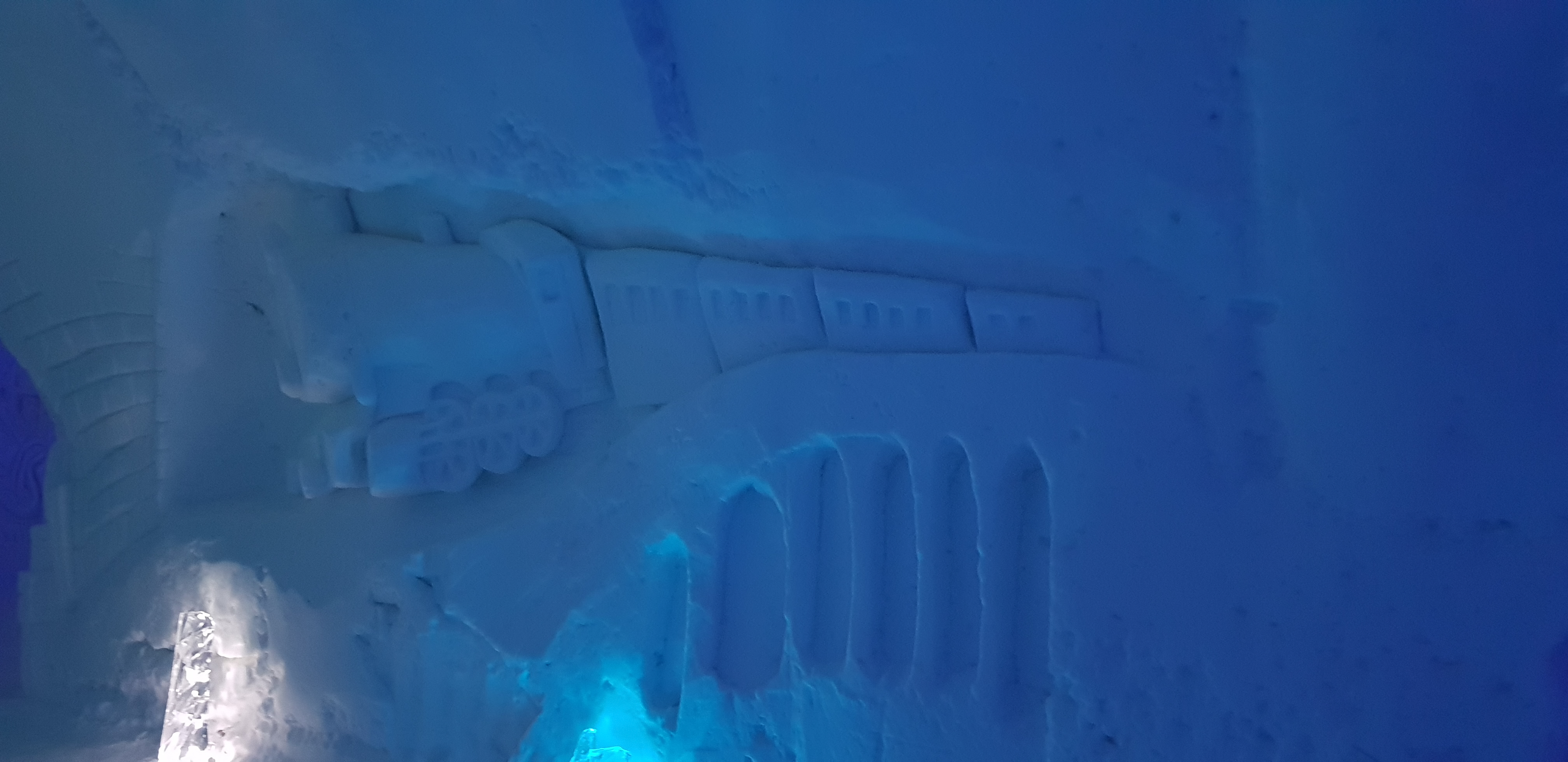 The Hogwarts Express is one of many sculptures carved into the walls of the Ice Hotel.