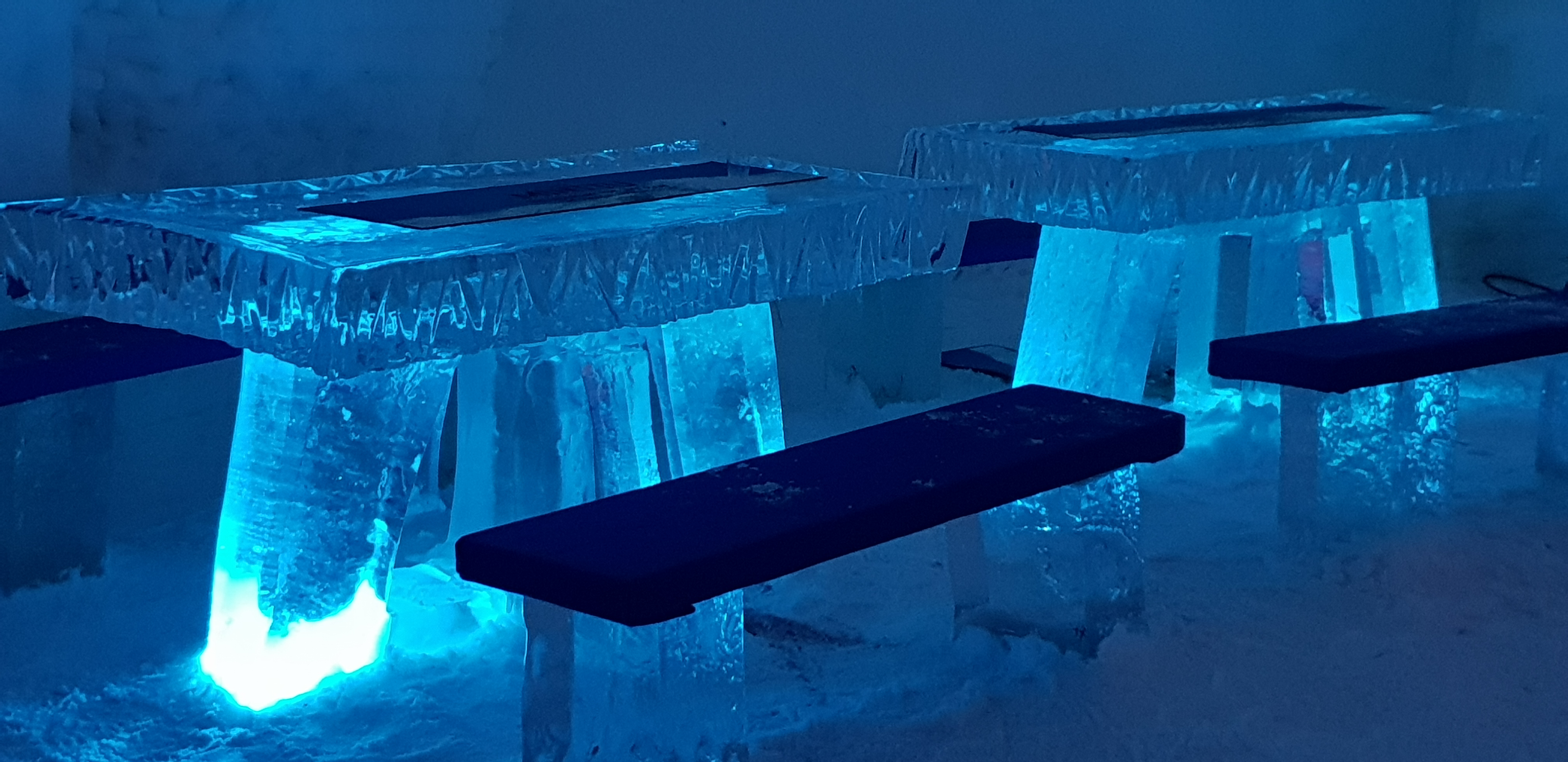The Ice Bar's decor includes ice tables and benches.