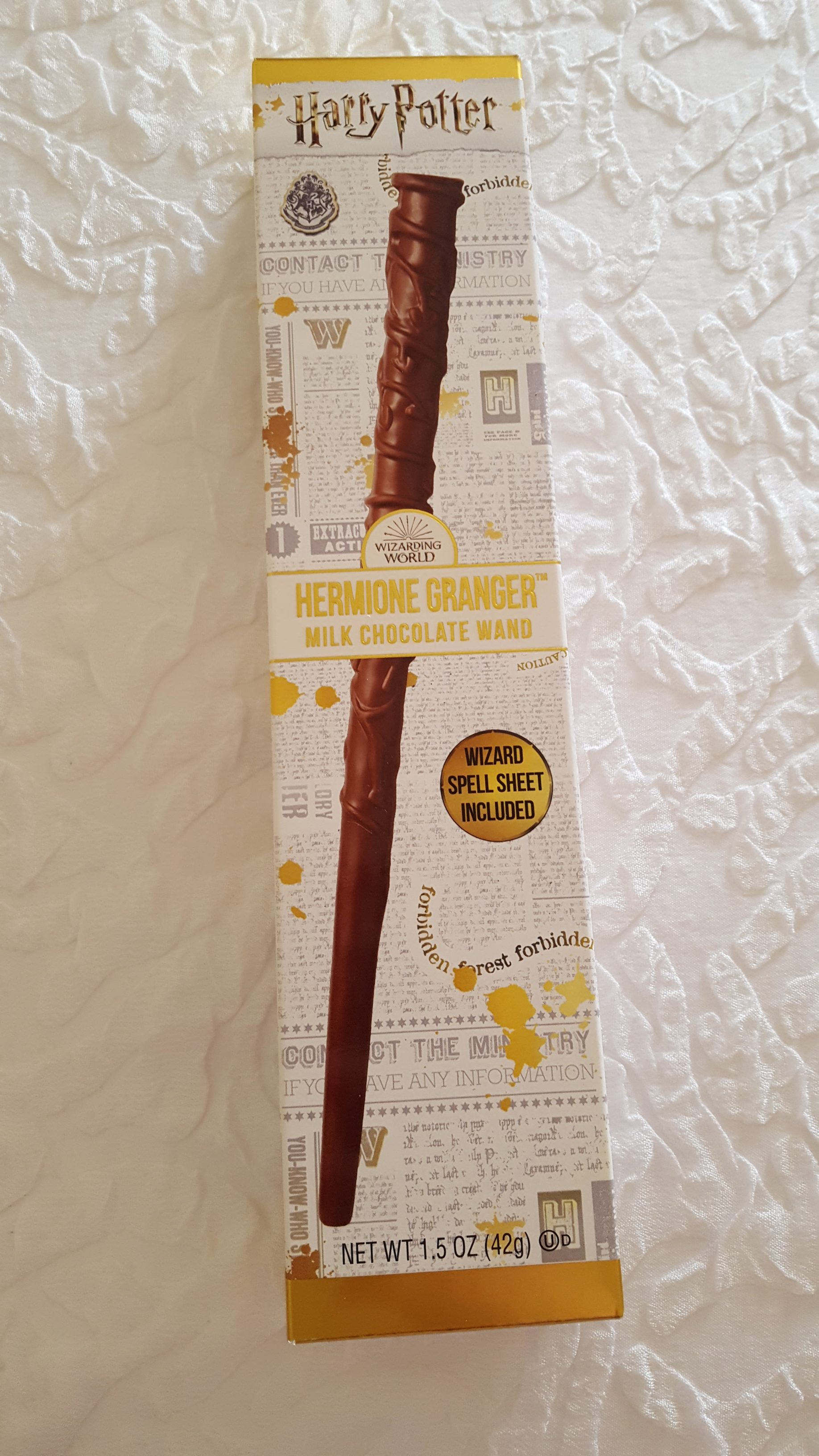 Jelly Belly Hermione Granger chocolate wand box, front view showing the vine detail on her wand