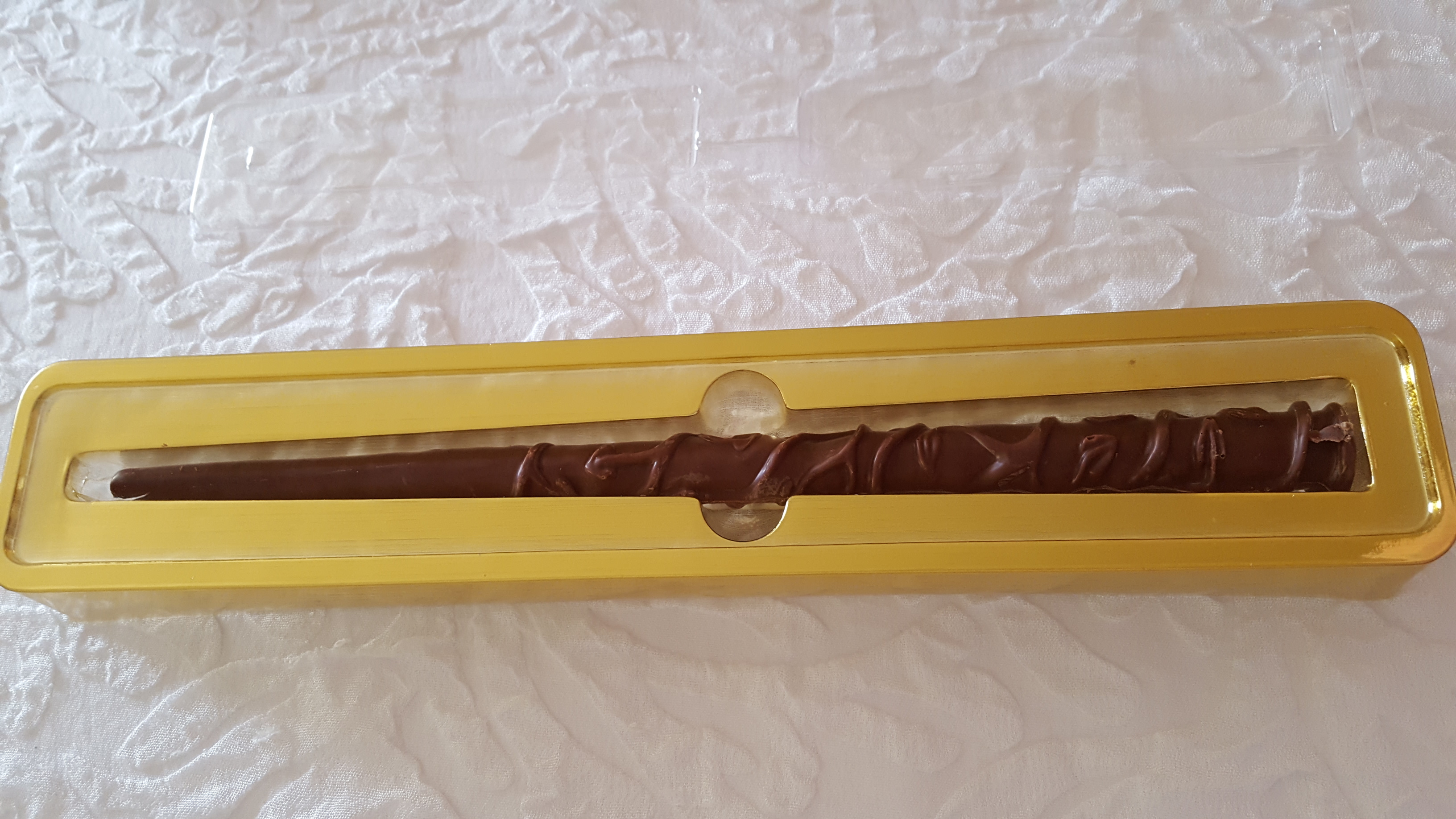 Jelly Belly Hermione Granger chocolate wand in the golden tray