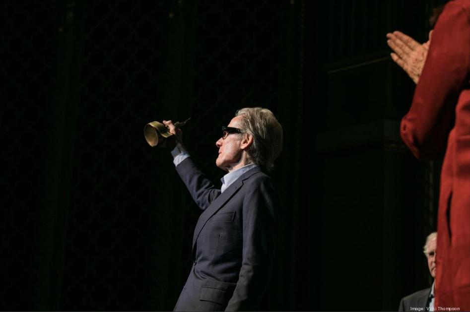 Bill Nighy raises his Maverick Spirit Award aloft.