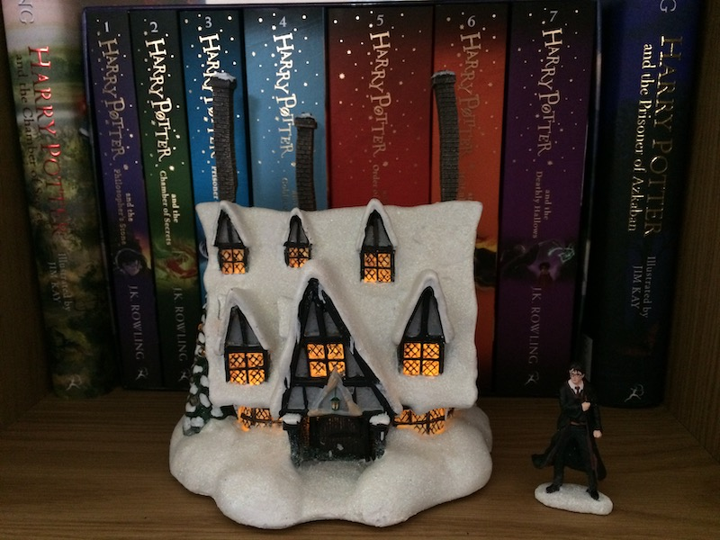 """Dim the lights, add some batteries, and flip the switch on the back of the """"THREE BROOMSTICKS PUB™"""", and the magic of this collector's item is revealed."""