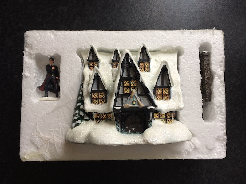 """The """"THREE BROOMSTICKS PUB™"""" collector's model comes with three detachable chimneys, a """"HARRY POTTER™"""" figurine, and a certificate of authenticity."""