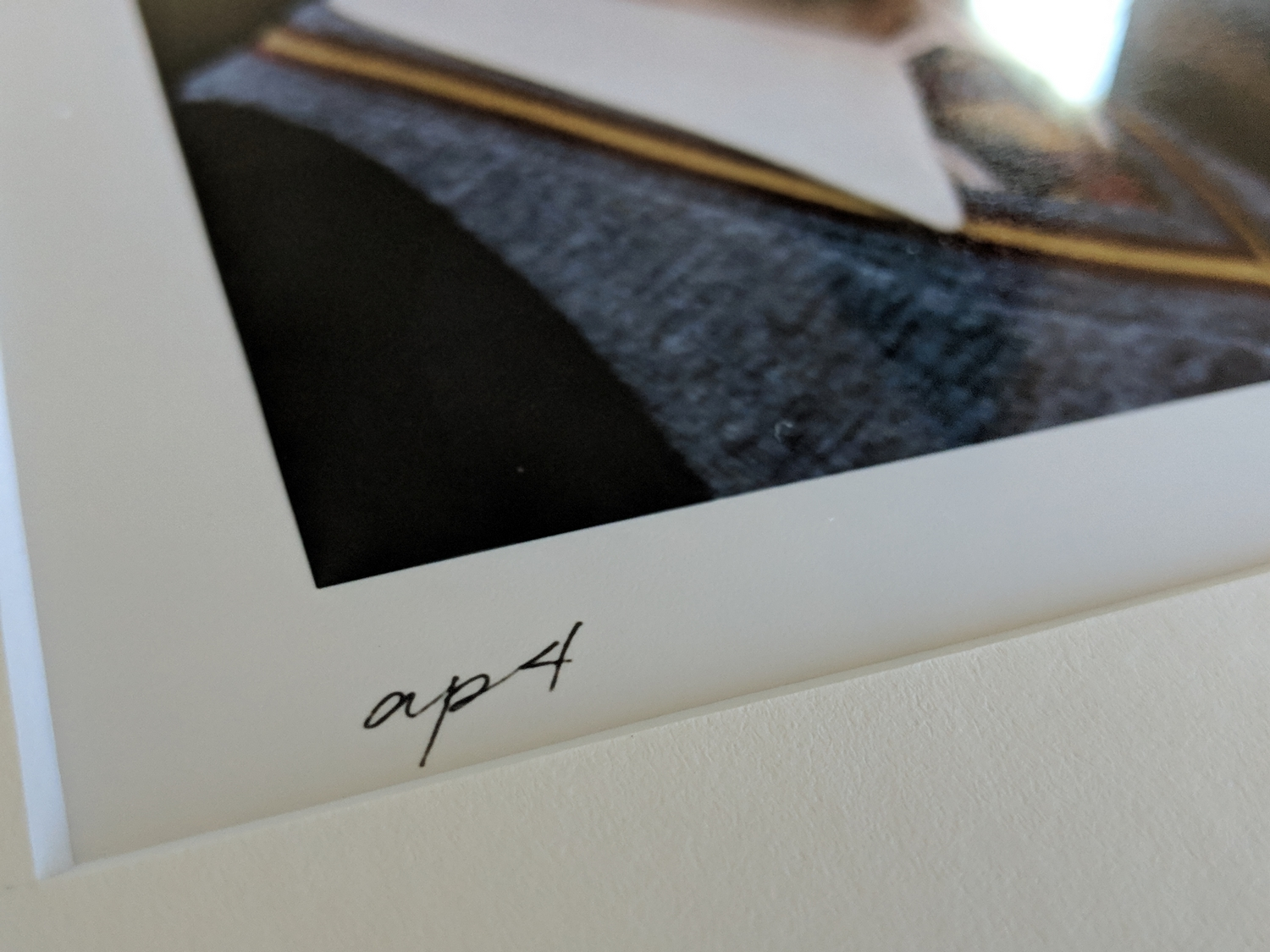 A close-up shot of my print's number – AP4. Regular prints will read something like 7/50.