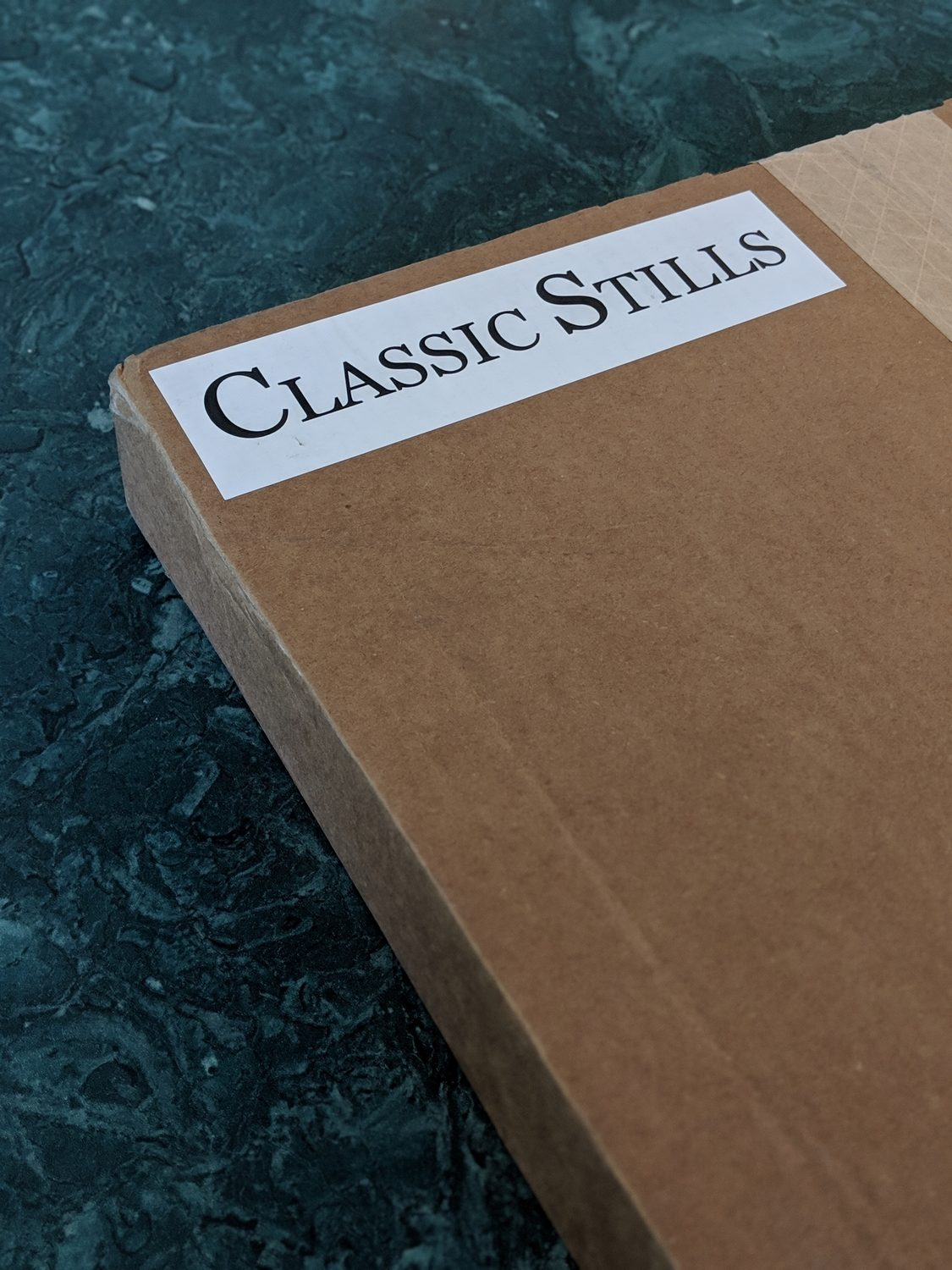 A close-up photo of the Classic Stills stickered logo