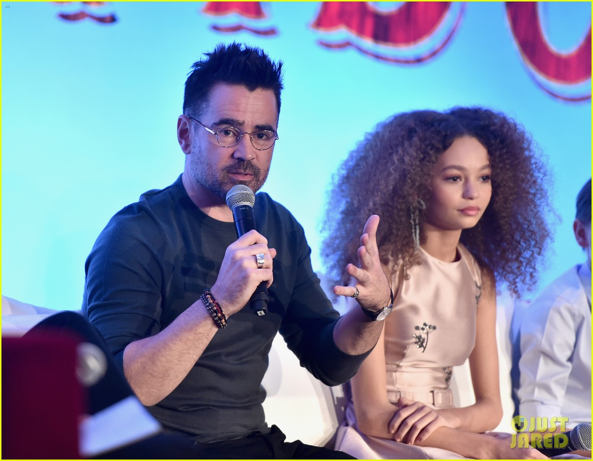"Colin Farrell speaks during a press conference for ""Dumbo"" as Nico Parker looks on."
