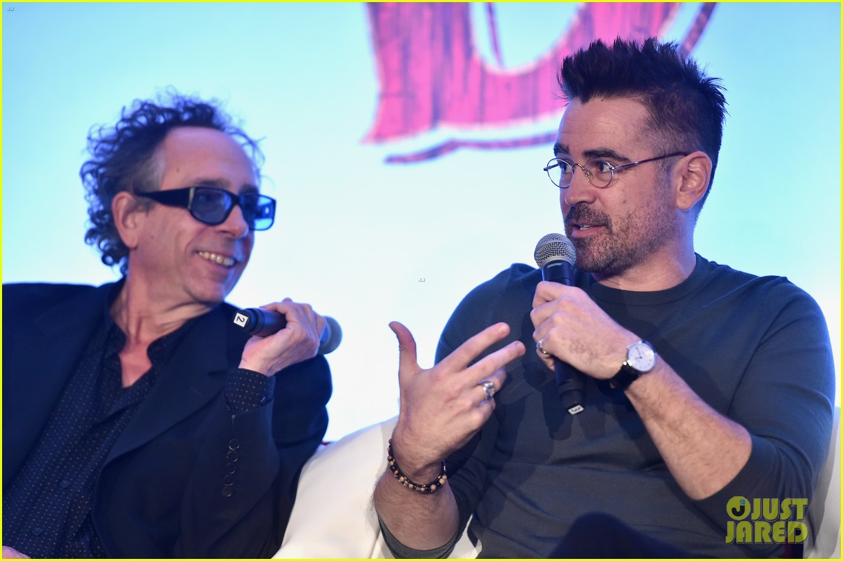 "Tim Burton smiles as Colin Farrell answers a question at the ""Dumbo"" press conference."