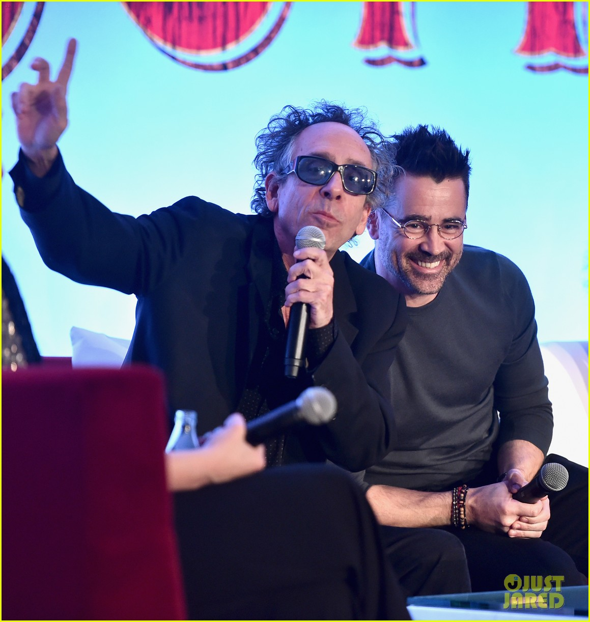 "Colin Farrell laughs as Tim Burton answers a question during the ""Dumbo"" press conference."