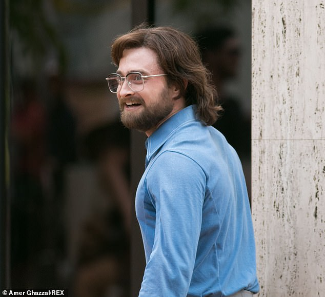 "Daniel Radcliffe flashes a smile on the set of ""Escape from Pretoria""."