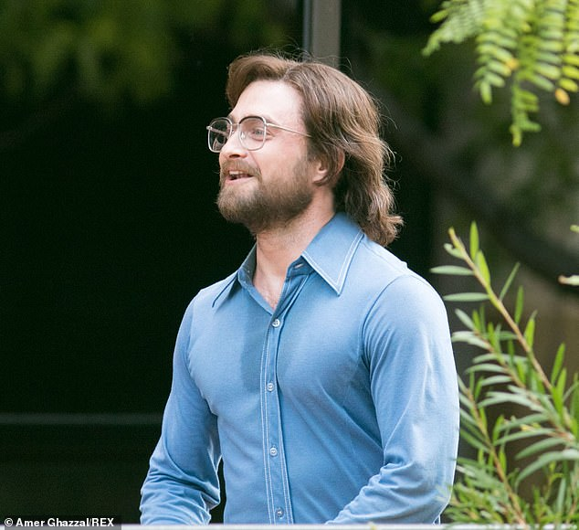"Daniel Radcliffe relaxes for a moment on the set of ""Escape from Pretoria""."