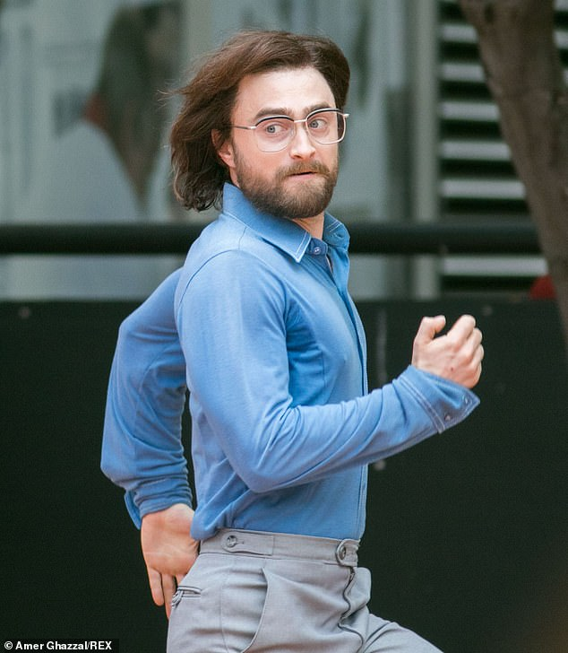 "Daniel Radcliffe checks his surroundings while running through the streets during filming for ""Escape from Pretoria""."