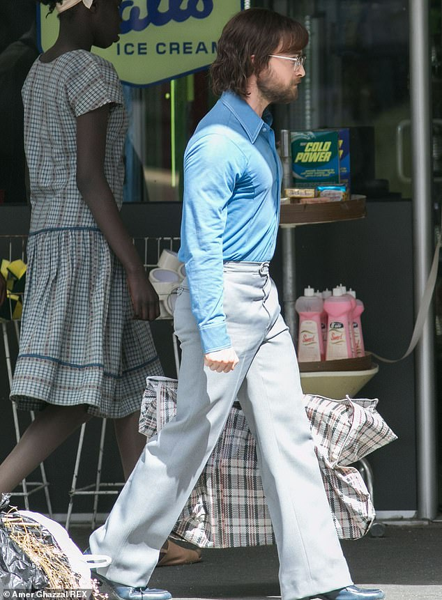 "Daniel Radcliffe walks along a busy sidewalk in Adelaide while filming a scene for ""Escape from Pretoria""."