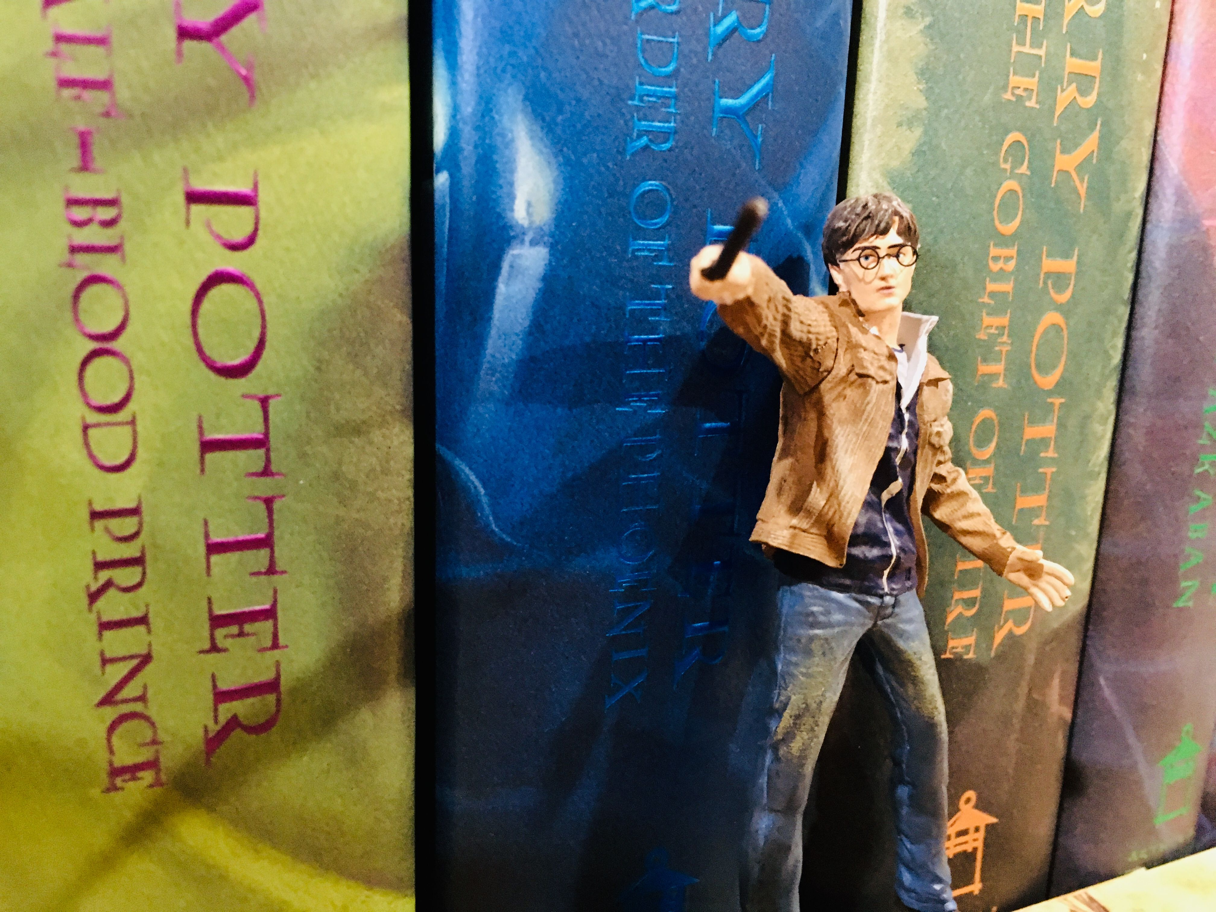 Harry's wand hand is outstretched as he prepares to fight He-Who-Must-Not-Be-Named.