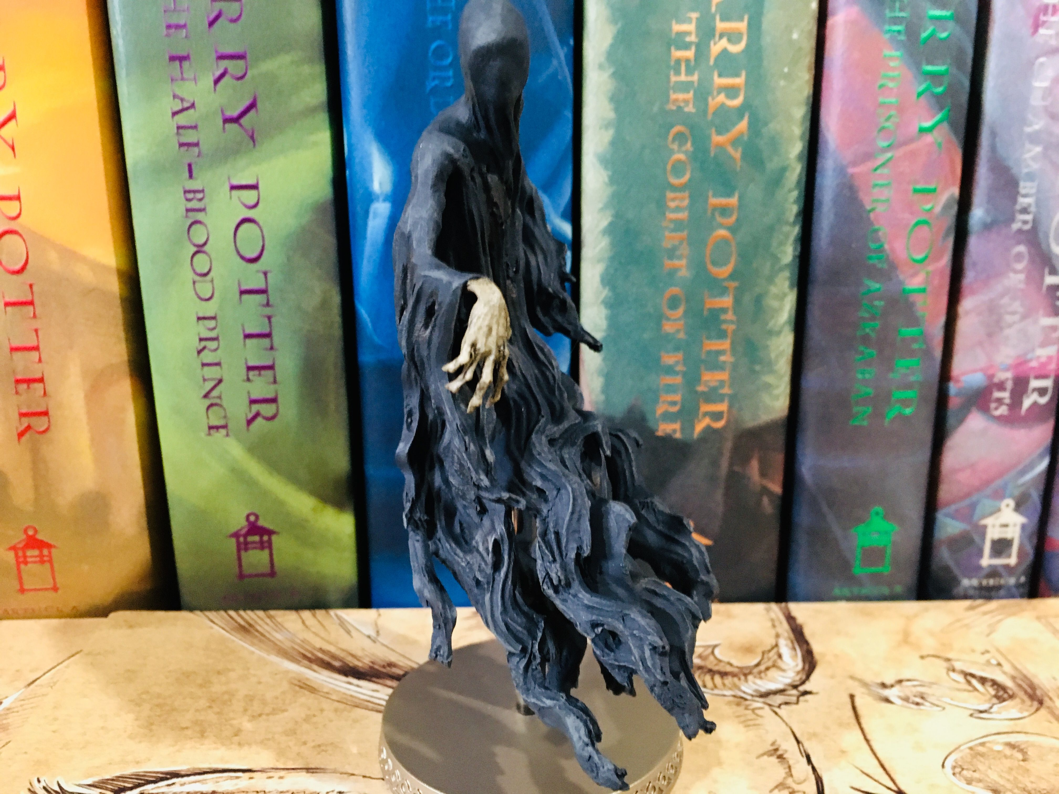 From the side, one can observe the detail in the Dementor's withered hand.