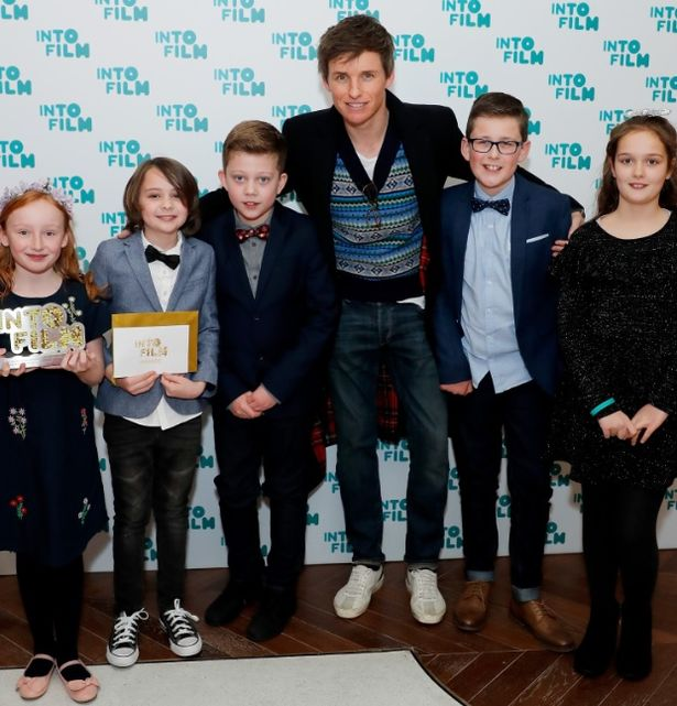 """Eddie Redmayne at the Into Film Awards 2019 with Rosie Whittle, Albert Wilson, Thomas Milner, Finley Arnott, and Layla White from Hornsea Community Primary School, who won Best Film for """"Anti-Bullying"""""""