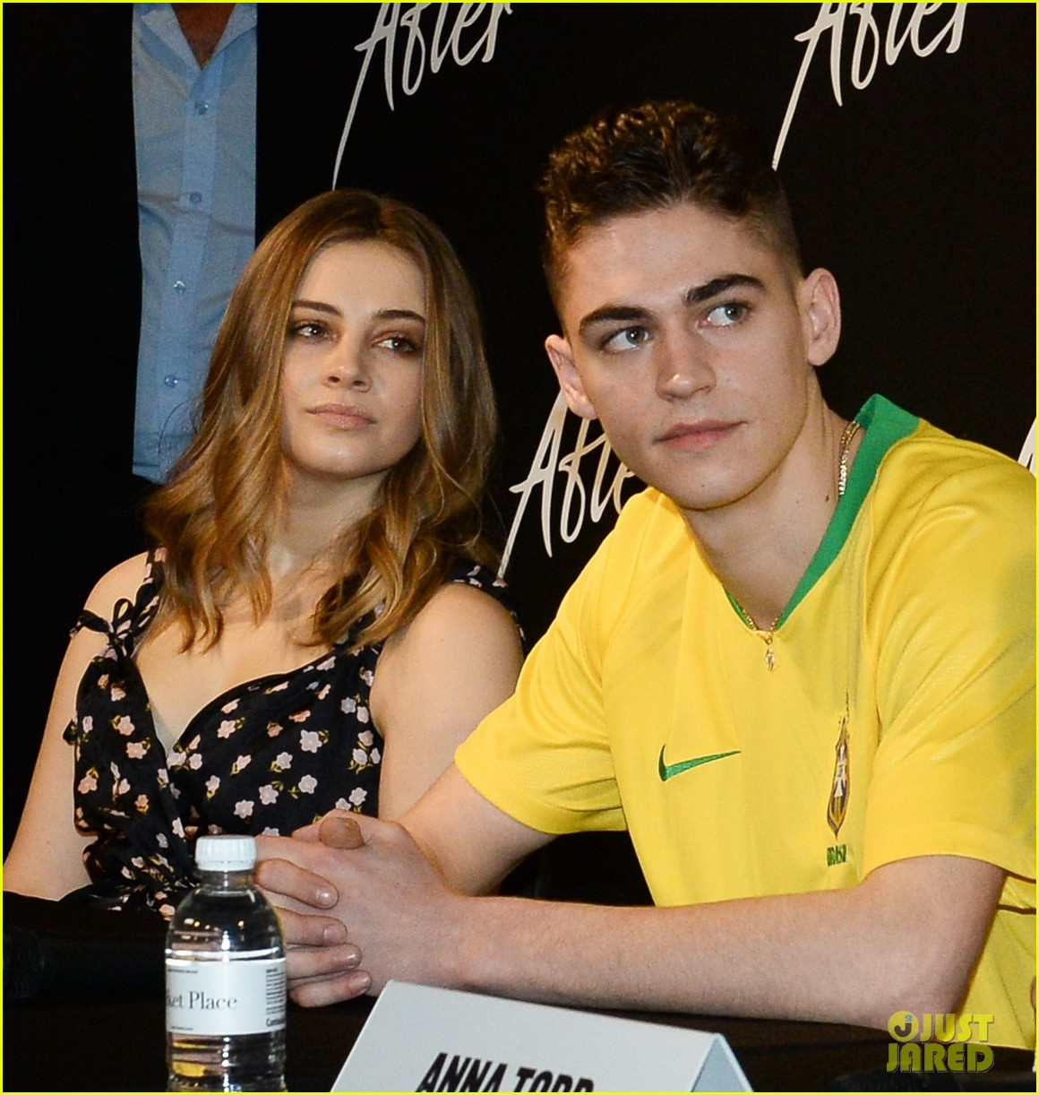 "Hero Fiennes-Tiffin and costar Josephine Langford listen to a question during a Brazilian press event for ""After""."